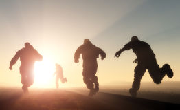 A group of men. Running in from the sun Stock Image