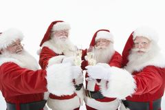 Group Of Men In Santa Claus Outfits Toasting Flutes Of Champagne Stock Photos