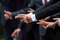 Group of men in suits show different hand gestures Royalty Free Stock Photo