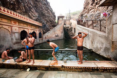 Group of men swimming in the pool between the rocks. JAIPUR, INDIA: Group of men swimming in the pool between the rocks. Jaipur, with population 6,664000 people Royalty Free Stock Photo