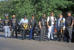 A group of men with their Harley Davidsons from the Latin American Motorcycle Association take a break in Dallas, Texas during the Royalty Free Stock Photography
