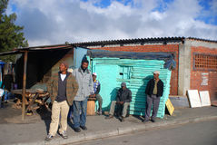 Group of men walk on the street in Khayelitsha township Stock Images
