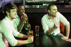 Group of men watching television in bar Royalty Free Stock Image