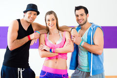 Group of men and women dancing zumba Stock Images