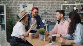 Group of men and women having conversation laughing during business meeting stock footage