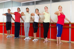 Group of  men and women practicing at the ballet barre Royalty Free Stock Photography