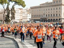 Group men and women run start of race in piazza Rome during Rome marathon. Rome, Italy - April 8, 2018: group men and women run start of race in piazza Rome royalty free stock photos