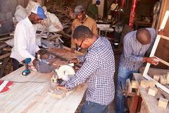 Group of men at work in a carpentry workshop, South Africa royalty free stock photography