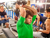 Group of men working his body at gym. Royalty Free Stock Photography
