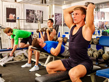 Group of men working his body at gym. Stock Photos