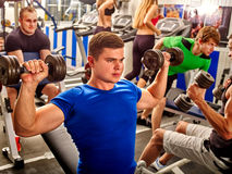 Group of men working his body at gym. Royalty Free Stock Images