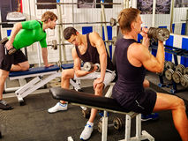 Group of men working his body at gym Stock Images
