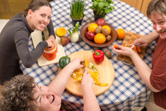 Group with a mentally disabled woman cooking together Stock Images