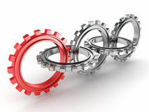 Group of metallic gears and one red Stock Image