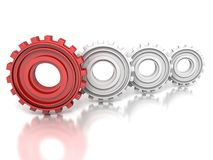 Group of metallic gears and one red concept leader Stock Image