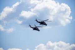 Group mi-24 performing aerobatics at an airshow Royalty Free Stock Images