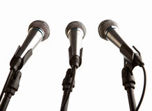 Group of microphones isolated Stock Photography