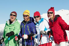 Group Of Middle Aged Couples. On Ski Holiday In Mountains stock images