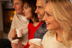 Group Of Middle Aged Couples With Hot Drinks Stock Photography