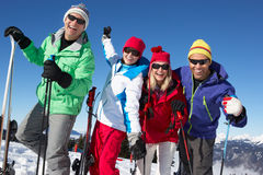 Group Of Middle Aged Couples On Ski Holiday. In Mountains Posing For Camera stock photography
