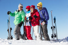 Group Of Middle Aged Couples On Ski Holiday. In Mountains Laughing royalty free stock photography