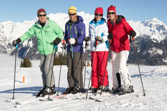 Group Of Middle Aged Couples On Ski Holiday. In Mountains Smiling At Camera royalty free stock photos
