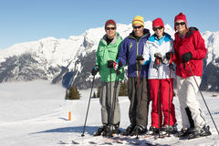 Group Of Middle Aged Couples On Ski Holiday. In Mountains stock photography