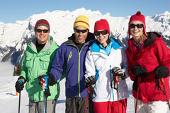 Group Of Middle Aged Couples On Ski Holiday. In Mountains royalty free stock photo