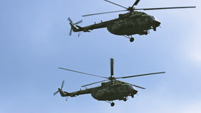 A group of military helicopters flying very close. Russian and US Army. stock video