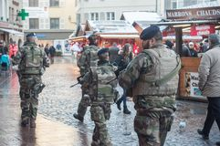 Group of military patrolling with machines gun in christmas market. Mulhouse - France - 9 December 2017  - group of military patrolling with machines gun in Stock Image