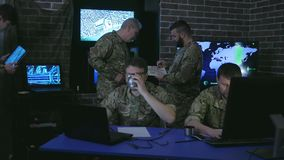 Group military IT professionals, on briefing, in monitoring stock video