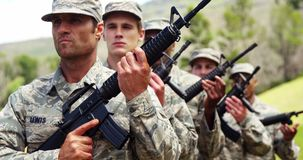 Group of military soldiers standing with rifles 4k. Group of military soldiers standing with rifles at boot camp 4k stock video footage