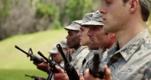 Group of military soldiers standing with rifles 4k. Group of military soldiers standing with rifles at boot camp 4k stock video