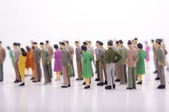 Group of miniature people over white. Group of miniature people over white background Royalty Free Stock Images