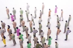 Group of miniature people over white background. Crowd Royalty Free Stock Photography
