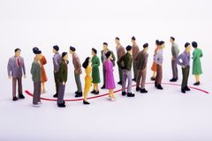 Group of miniature people over white background standing in line royalty free stock photos