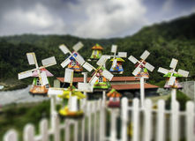 Group of miniature traditional Dutch old wooden windmill with top hill view Stock Image