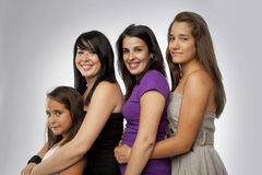 Group of Mixed Ages Girls. In a grey background stock photo