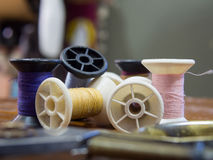 Group mixed color of old vintage yarn reels focus only some part. Of them and blur out background and foreground royalty free stock photo