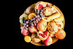 Group of mixed fruits on a tray, isolated on black background Stock Images
