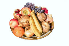 Group of mixed fruits on a tray, isolated on white background Stock Photos
