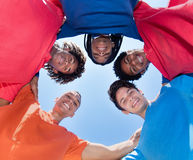 Group of mixed race male young adults in a circle. In the summer Royalty Free Stock Image