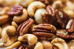 Group of mixed roasted nuts Stock Photos