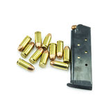 Group of 11mm bullets and magazine isolated Stock Photography