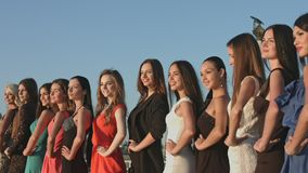 Group of models posing for the photographer on the street stock video footage