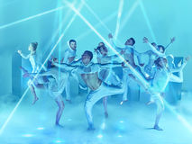 The group of modern ballet dancers. On blue studio background Royalty Free Stock Photography