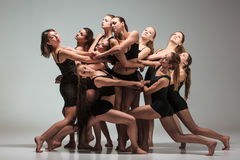 The group of modern ballet dancers. Dancing on gray background Royalty Free Stock Images