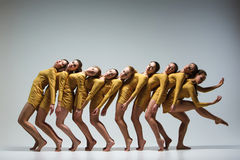 The group of modern ballet dancers. Dancing on gray background Stock Photos
