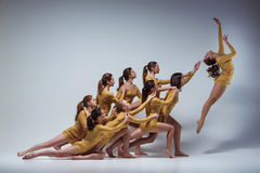 The group of modern ballet dancers. Dancing on gray background Royalty Free Stock Photo