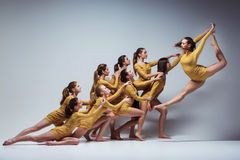 The group of modern ballet dancers. Dancing on gray background Stock Image